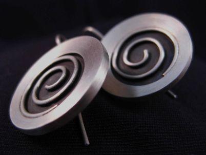 Stellar spiral earring